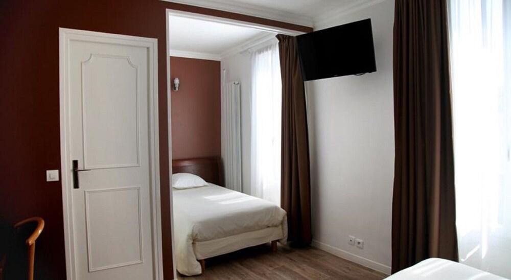 hotel briand paris france. Black Bedroom Furniture Sets. Home Design Ideas