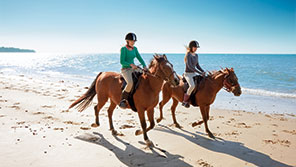 riding horses on a beach