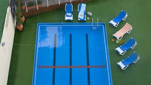 Seasonal outdoor pool, pool umbrellas