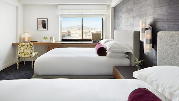 Italiaanse Frette-lakens, luxe beddengoed, pillowtop-bedden, een minibar