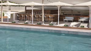 Seasonal outdoor pool, open 11:00 AM to 8:00 PM, pool umbrellas