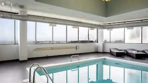 Indoor pool, open 5:00 AM to 11:00 PM, pool loungers