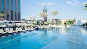 4 outdoor pools, open 8:00 AM to 6:00 PM, pool cabanas (surcharge)