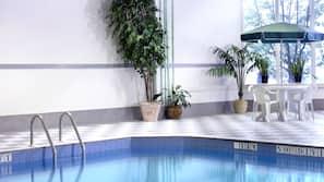 Indoor pool, open 6:00 AM to 11:00 PM, pool umbrellas