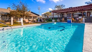 Seasonal outdoor pool, open 8:30 AM to 10:00 PM, pool umbrellas