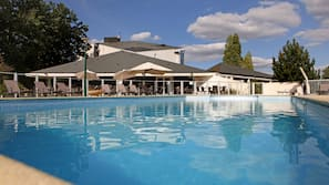 Seasonal outdoor pool, open 8 AM to 8:30 PM, pool loungers