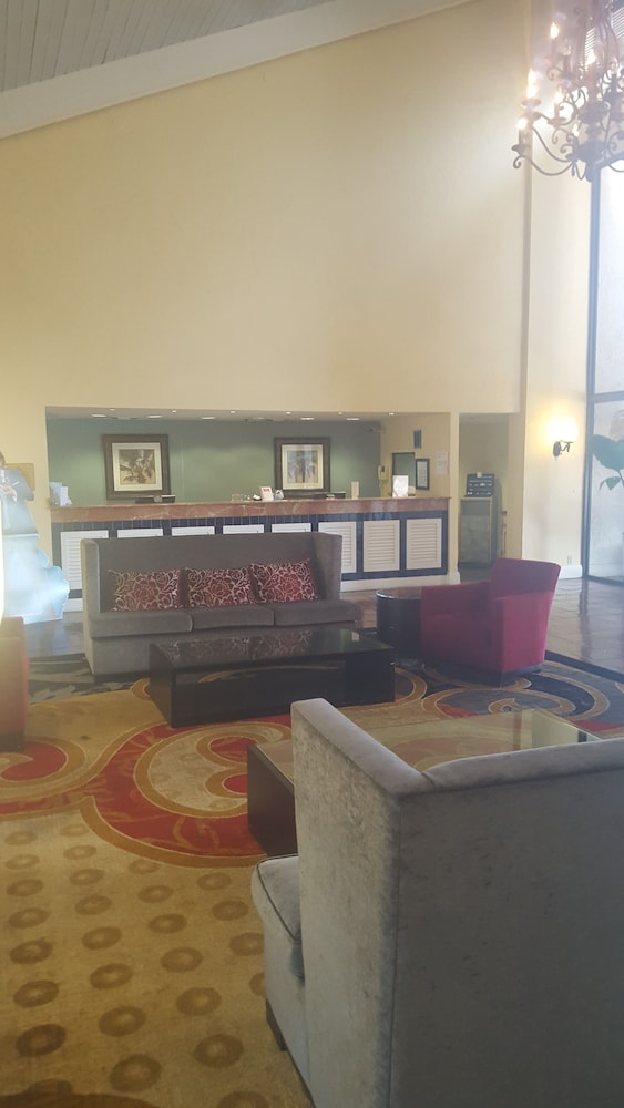 Ramada By Wyndham West Palm Beach Airport 3 0 Out Of 5 Hotel Front Evening Night Featured Image Lobby