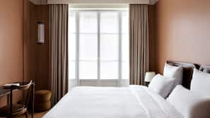 Premium bedding, memory-foam beds, in-room safe, blackout curtains