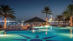 Outdoor pool, open 8:00 AM to 7:00 PM, pool umbrellas