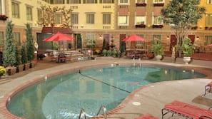 Indoor pool, open 7:00 AM to 11:00 PM, pool umbrellas