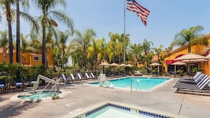 Outdoor pool, open 9:00 AM to 8:00 PM, pool umbrellas