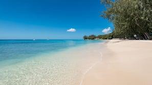 On the beach, white sand, sun-loungers, scuba diving