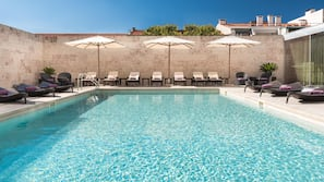 Outdoor pool, open 10:00 AM to 10:00 PM, pool umbrellas, pool loungers