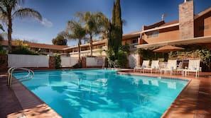 Outdoor pool, open 7:00 AM to 6:00 PM, pool umbrellas, pool loungers