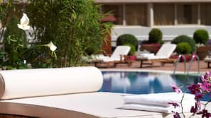 Outdoor pool, open noon to 9:00 PM, pool umbrellas, pool loungers