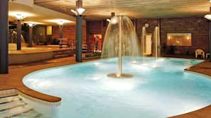 Indoor pool, open 9:30 AM to 1:30 PM, pool loungers