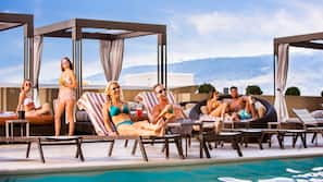Outdoor pool, open 9:00 AM to 9:00 PM, cabanas (surcharge)