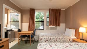 Pillow top beds, blackout curtains, iron/ironing board, free WiFi
