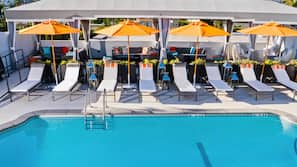 Outdoor pool, open 7 AM to 11 PM, free cabanas, pool umbrellas