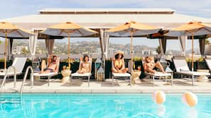 Outdoor pool, open 7 AM to 11 PM, free pool cabanas, pool umbrellas