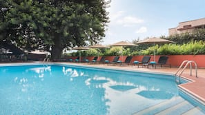 Outdoor pool, open 7:00 AM to 9:30 PM, pool umbrellas, sun loungers