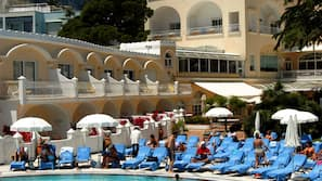Indoor pool, outdoor pool, open 9 AM to 9 PM, sun loungers