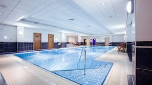 Indoor pool, open 7 AM to 10 PM, pool loungers
