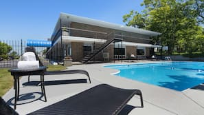 Seasonal outdoor pool, open 10:00 AM to 10:00 PM, pool loungers