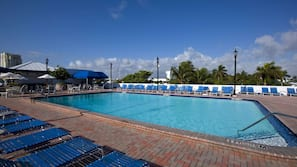 Outdoor pool, open 7:00 AM to 10:00 PM, cabanas (surcharge)