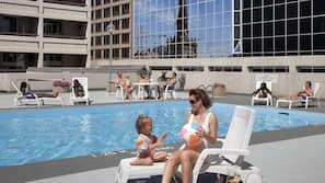 Indoor pool, open 7:00 AM to 11:00 PM, pool loungers