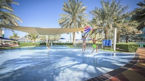 Outdoor pool, open 7:00 AM to 7:00 PM, pool umbrellas