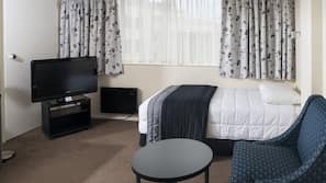 Desk, blackout curtains, iron/ironing board, bed sheets
