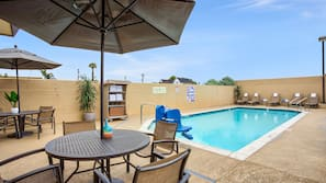 Outdoor pool, open 7:00 AM to 10 PM, pool umbrellas