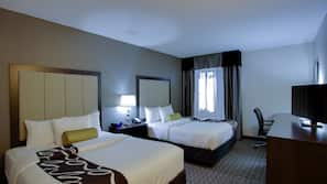 Premium bedding, desk, laptop workspace, blackout curtains