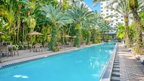 Outdoor pool, open 7:00 AM to 7:00 PM, cabanas (surcharge)
