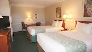 Premium bedding, desk, laptop workspace, blackout drapes