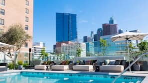 Outdoor pool, open 6:00 AM to 8:00 PM, free cabanas, pool umbrellas