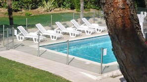 Outdoor pool, open 8 AM to 10 PM, pool umbrellas, pool loungers