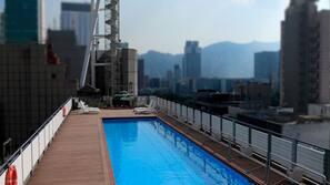 Seasonal outdoor pool, pool umbrellas, lifeguards on site