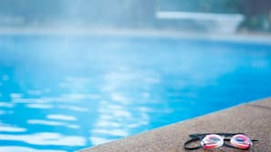 Outdoor pool, open 9:00 AM to 10:30 PM, pool umbrellas, pool loungers