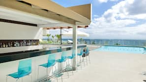 Outdoor pool, open 8 AM to 7 PM, pool umbrellas