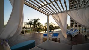 Outdoor pool, open 6:30 AM to 10:00 PM, free cabanas, pool umbrellas