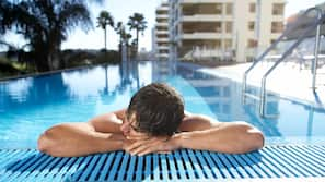 Outdoor pool, open 6:30 AM to 10:00 PM, free pool cabanas