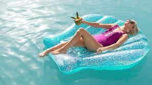 Outdoor pool, open 6:00 AM to 11:00 PM, pool cabanas (surcharge)