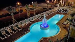 Seasonal outdoor pool, open 6:00 AM to 11:00 PM, pool umbrellas