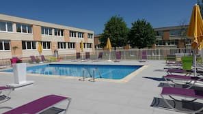 Outdoor pool, open 9 AM to 8 PM, pool umbrellas, sun loungers