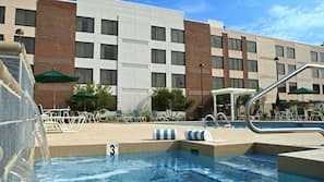 Outdoor pool, open 7:00 AM to 10:00 PM, pool umbrellas