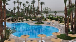 Outdoor pool, open 9:00 AM to 5:00 PM, pool umbrellas, sun loungers