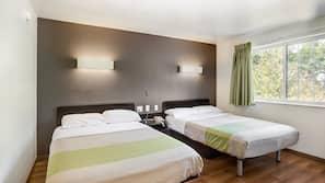 Desk, iron/ironing board, bed sheets, alarm clocks