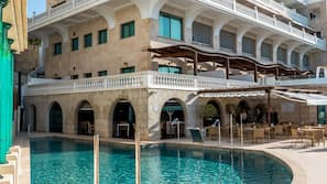 Indoor pool, outdoor pool, open 11:00 AM to 7:00 PM, pool umbrellas